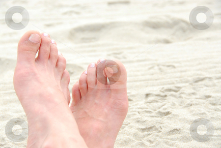 Sandy feet stock photo, Crossed sandy feet on a beach by Elena Elisseeva