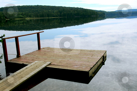 Lake dock stock photo, Old wooden boat dock on a beautiful lake in the evening by Elena Elisseeva