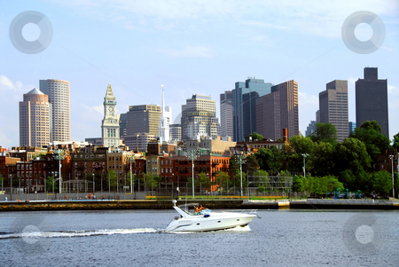 Boston skyline stock photo, Motorboat in a harbor in front of a Boston skyline on a sunny summer day by Elena Elisseeva