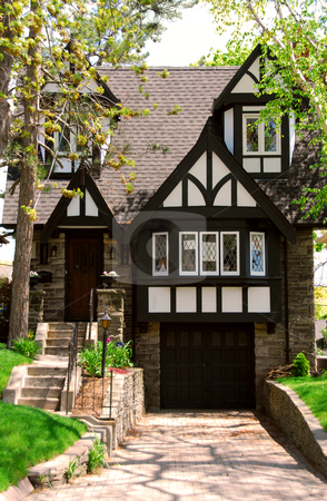 House stock photo, Residential tudor style house with green trees by Elena Elisseeva