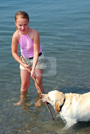 Girl play dog stock photo, Young pretty girl playing with a dog in lake water by Elena Elisseeva