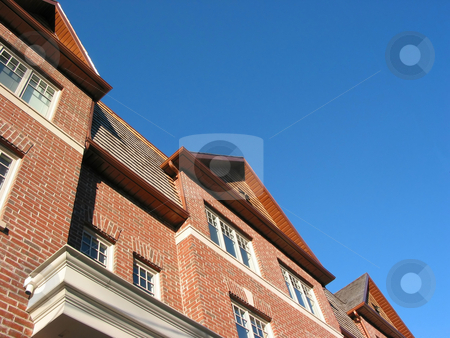New brick townhomes stock photo, New brick townhomes on the background of bright blue sky by Elena Elisseeva