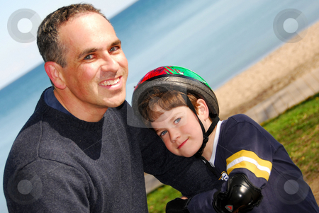 Father and son stock photo, Portrait of father and son, focus on boy's face by Elena Elisseeva