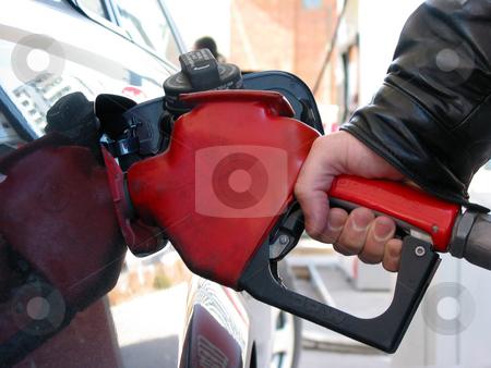 Fuel pump hand stock photo, Hand holding a has pump nozzle fueling a car, closeup by Elena Elisseeva