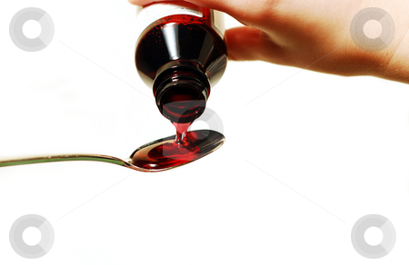 Cough syrup stock photo, Cough syrup poured into a spoon by Elena Elisseeva