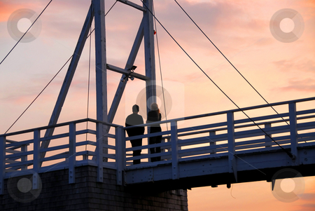 Couple watching sunset stock photo, Couple watching sunset on a footbridge in Perkins Cove, Maine by Elena Elisseeva