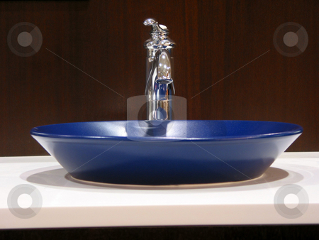 Modern bathroom sink stock photo, Blue sink in a modern bathroom by Elena Elisseeva