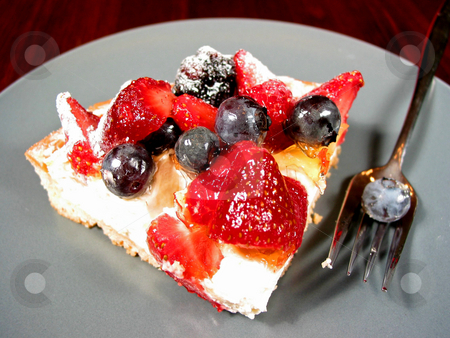 Slice of berry cake stock photo, Slice of mixed berry tart on a plate by Elena Elisseeva