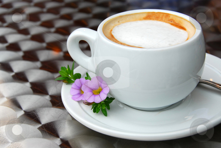 Cup of coffee stock photo, Cup of coffee with flowers on saucer by Elena Elisseeva