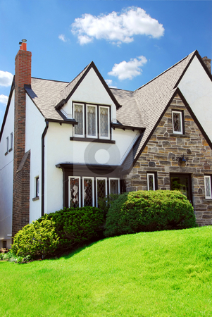 House stock photo, Residential tudor style house with blue sky in background by Elena Elisseeva