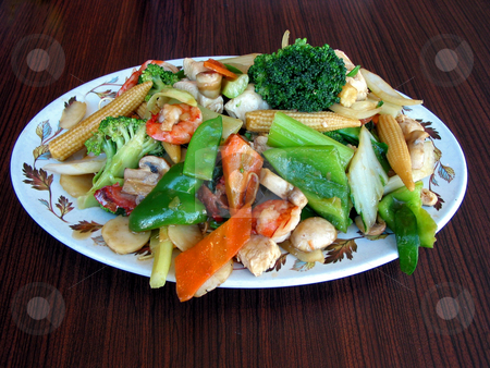Chow mein stock photo, Generious portion of chow mein served on a plate by Elena Elisseeva