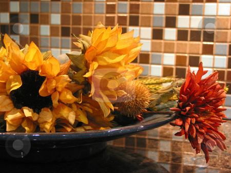 Interior decoration stock photo, Artificial flowers in a bowl as kitchen interior decoration by Elena Elisseeva