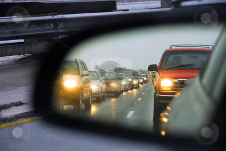 Traffic jam mirror stock photo, Feflection of a traffic jam in a sideview mirror by Elena Elisseeva