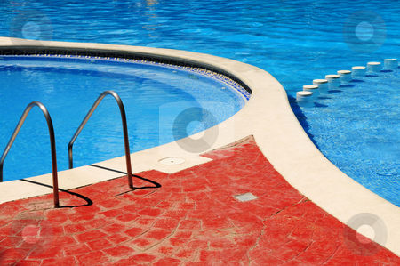 Outdoor swimming pool stock photo, Detail of outdoor swimming pool at tropical resort by Elena Elisseeva