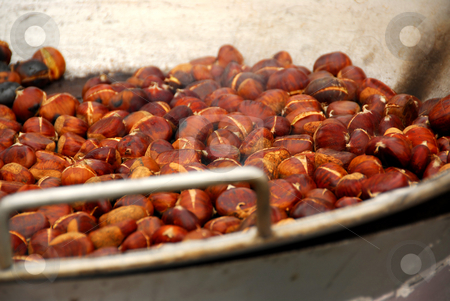 Roasting chestnuts stock photo, Chestnuts roasting in a pan at street vendor's stand by Elena Elisseeva