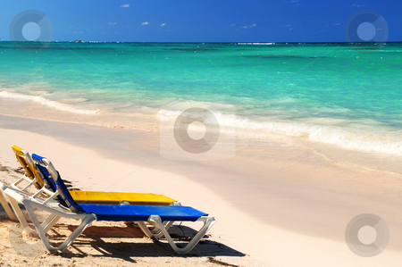 Chairs on sandy tropical beach stock photo, Two vacation chairs on sandy tropical beach of Caribbean island by Elena Elisseeva