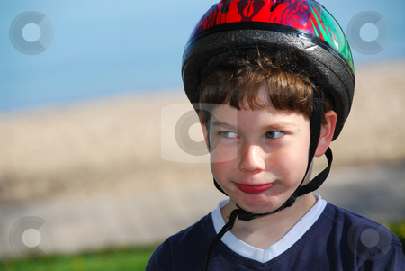 Boy portrait stock photo, Portrait of a young boy in a bicycle helmet by Elena Elisseeva