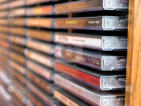 Music cd stack stock photo, Rows of music cds in a cd holder, shallow dof by Elena Elisseeva