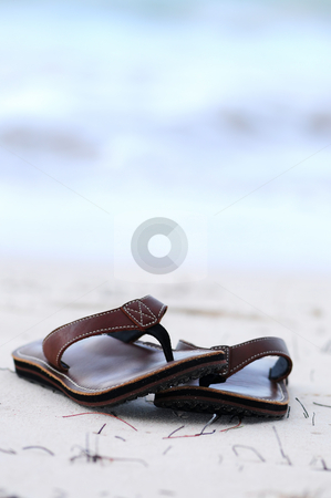 Flipflops on a sandy beach stock photo, Flipflops on a sandy ocean beach - summer vacation concept by Elena Elisseeva