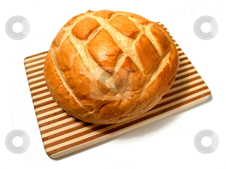 Bread loaf stock photo, Loaf of sourdough bread on cutting board isolated on white background by Elena Elisseeva