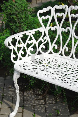 Bench stock photo, White wrought iron bench in a garden by Elena Elisseeva