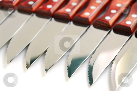 Steak knives row stock photo, Steak knives in a row on white background by Elena Elisseeva