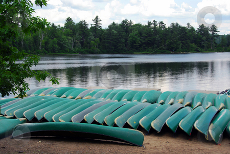 Canoes on lake shore stock photo, Canoes on lake shore in northern Ontario by Elena Elisseeva