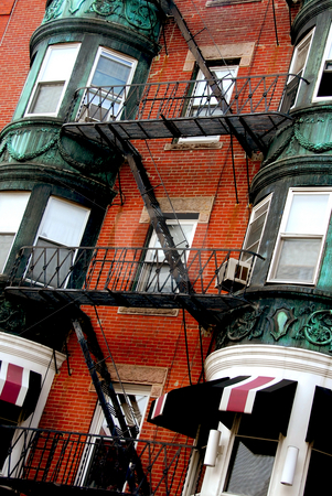 Boston house fragment stock photo, Fragment of a red brick house in Boston historical North End with wrought iron balconies and fire escapes by Elena Elisseeva