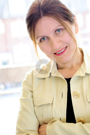 Portrait of a mature woman stock photo, Portrait of a mature smiling business woman by Elena Elisseeva