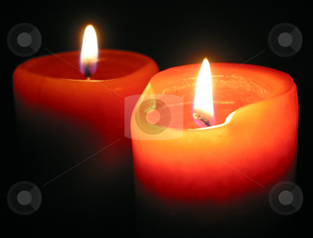 Burning candles stock photo, Two red candles burning in the dark by Elena Elisseeva