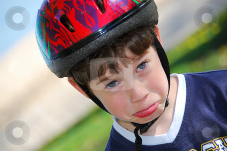 Silly boy portrait stock photo, Portrait of a cute little boy in bicycle helmet making faces by Elena Elisseeva