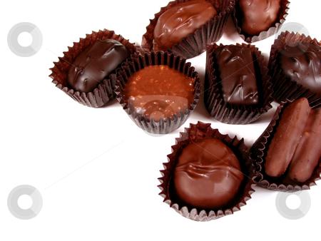 Chocolates on white 8 stock photo, Several chocolates on white background, closeup by Elena Elisseeva