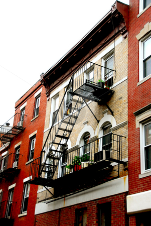Boston houses stock photo, Row of brick houses in Boston historical North End metal fire escapes by Elena Elisseeva