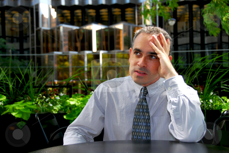 Businessman frustrated stock photo, Businessman sitting in outdoor cafe frustrated by Elena Elisseeva
