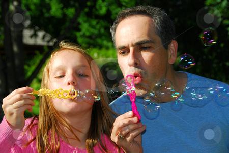 Family summer bubbles stock photo, Happy family blowing soap bubbles by Elena Elisseeva