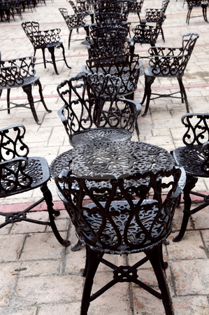 Wrought iron furniture stock photo, Wrought iron furniture on the outdoor cafe patio by Elena Elisseeva