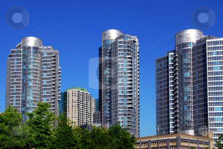 Modern condominium complex stock photo, Highrise buildings of a modern condominium complex by Elena Elisseeva