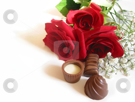 Rose bouquet with chocolates stock photo, Bouquet of red roses with chocolates on white background by Elena Elisseeva