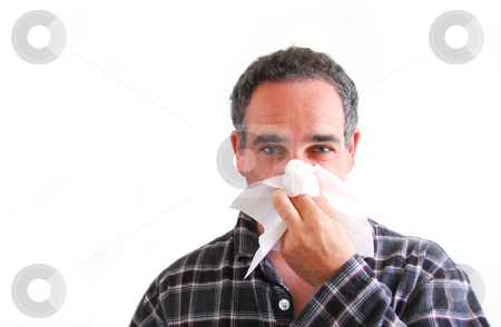 Man with cold blowing nose stock photo, Man with a flu blowing his nose by Elena Elisseeva