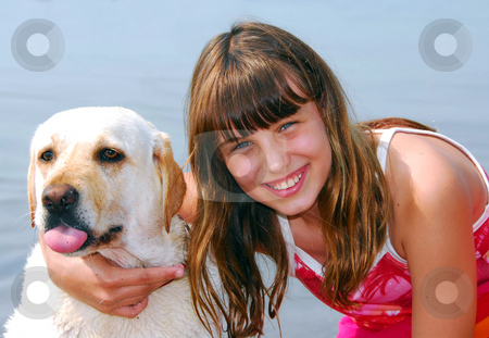 Girl dog portrait stock photo, Portrait of a young girl with a dog by Elena Elisseeva