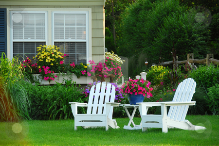 Two lawn chairs stock photo, Two lawn chairs in a beautifl garden by Elena Elisseeva