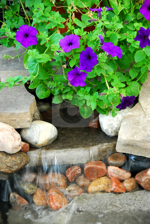 Rock fountain stock photo, Rock fountain in japanese garden by Elena Elisseeva