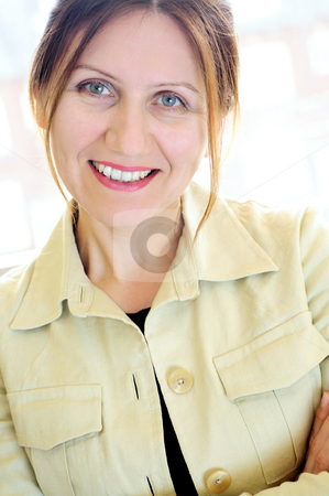 Portrait of a mature woman stock photo, Portrait of a mature smiling business woman by Elena Elisseeva