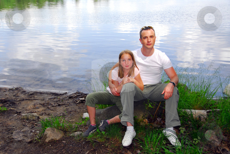 Portrait father daughter stock photo, Portrait of father and daughter on the lake shore by Elena Elisseeva