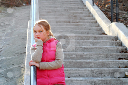 Girl child stairs stock photo, Young girl standing on concrete stairway by Elena Elisseeva