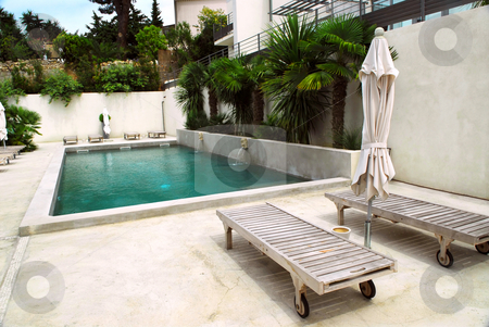 Swimming pool stock photo, Swimming pool of mediterranean villa in French Riviera by Elena Elisseeva