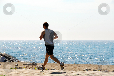 Man jogging stock photo, Man jogging in a beach by Elena Elisseeva