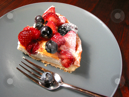 Slice of berry cake on a plate stock photo, Slice of mixed berry tart on a plate by Elena Elisseeva