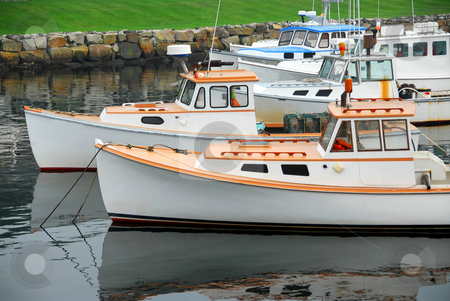 Fishing boats in harbor stock photo, Fishing boats in a harbor in Perkins Cove, Maine by Elena Elisseeva
