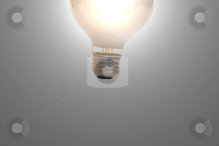 Illuminating Lightbulb stock photo, A lit lightbulb illuminating a dark background by Richard Nelson